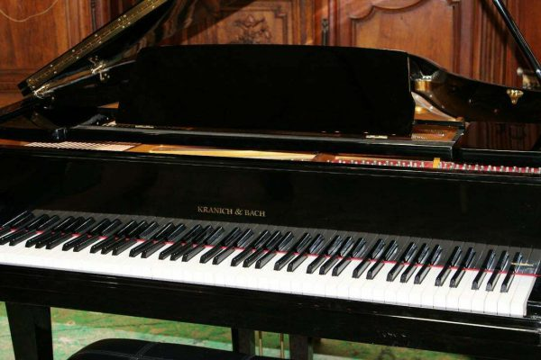 Polished black baby grand piano